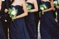 strapless and draped midnight blue mmaxi bridesmaid dresses look very chic, especially with metallic shoes