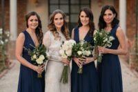 stylish midnight blue bridesmaid dresses with thick straps and deep plunging necklines plus nude heels