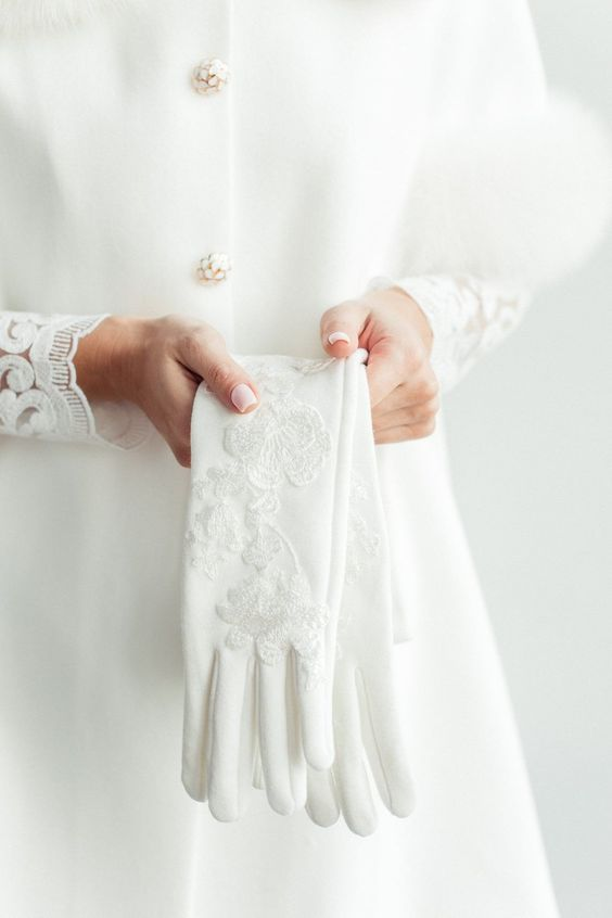 stylish white bridal gloves with lace appliques are adorable and will keep you both comfortable and refined and chic