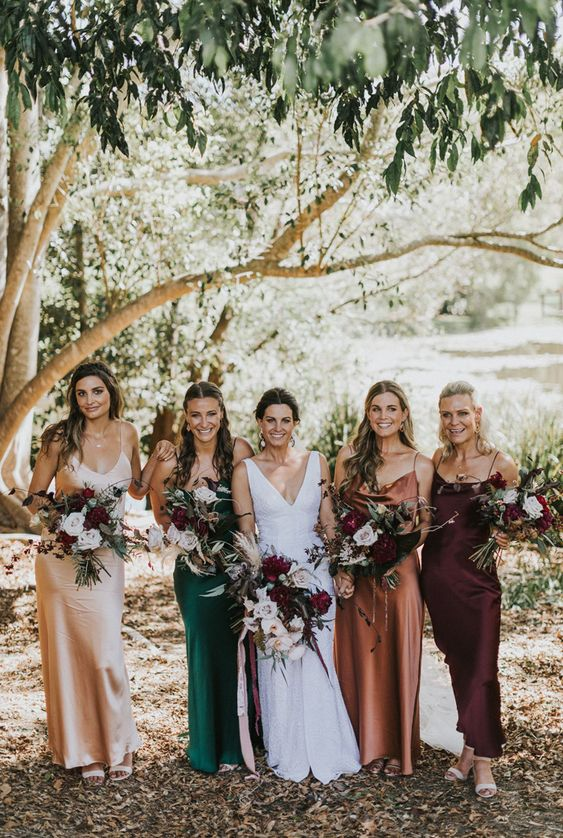 very cool slip maxi bridesmaid dresses in deep purple, rust, green and nude are perfect for a relaxed and chic fall wedding