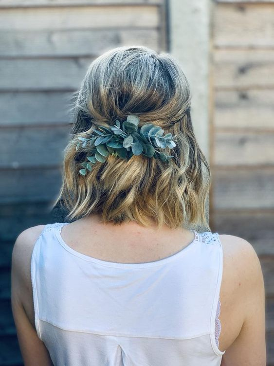 wavy medium length hair with twists and a touch of fresh eucalyptus is a lovely idea for a boho bride