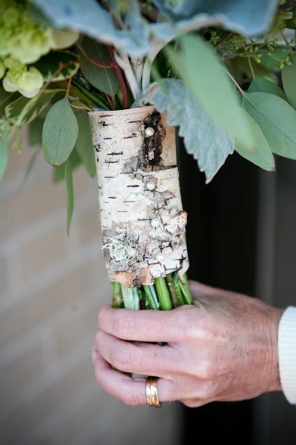 a birch bark wrap with pearl pins is a very cute rustic idea that looks chic