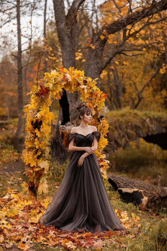 a black and grey off th shoulder tulle wedding dress wiht a train is a fresh take on a traditionally black Halloween wedding dress
