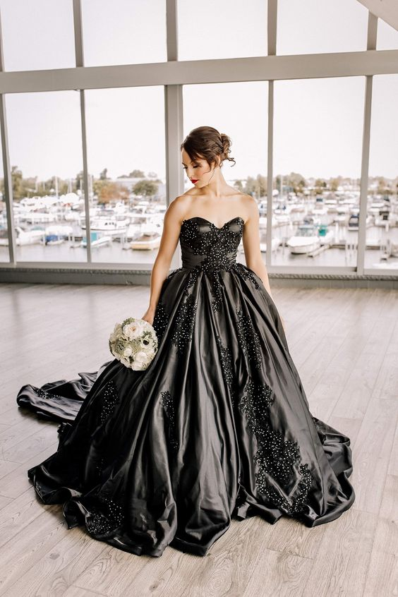 a black strapless wedidng ballgown with an embroidered lace applique bodice and a train is very refined and chic