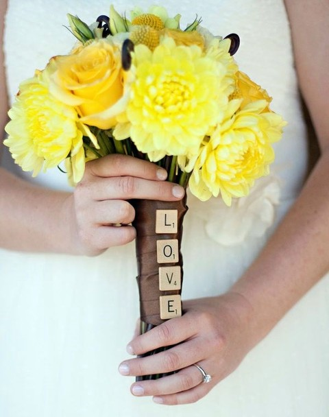 a brown bouquet wrap with scrabble LOVE letters is a very cute and whimsy idea