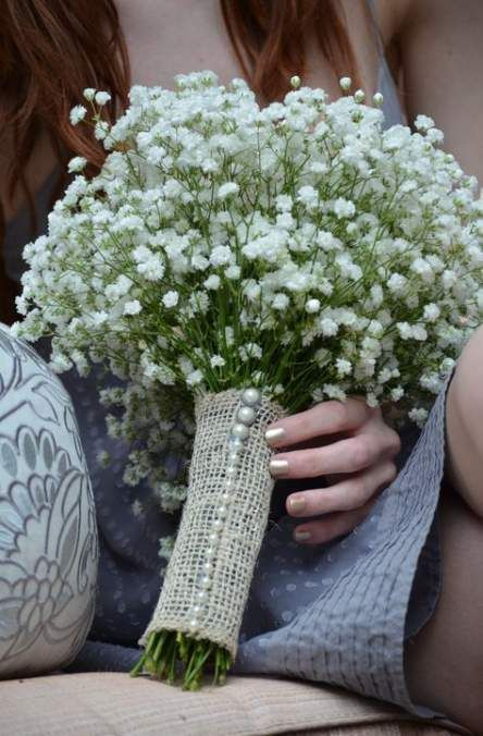 a burlap bouquet wrap with pearl pins is a very chic and traditionally rustic idea