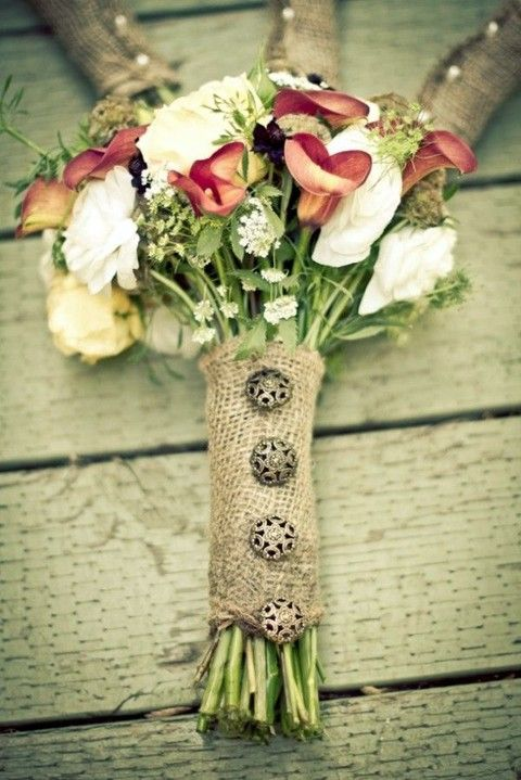 a burlap wrap with beautiful decorative buttons is a pretty accessory for a rustic wedding bouquet