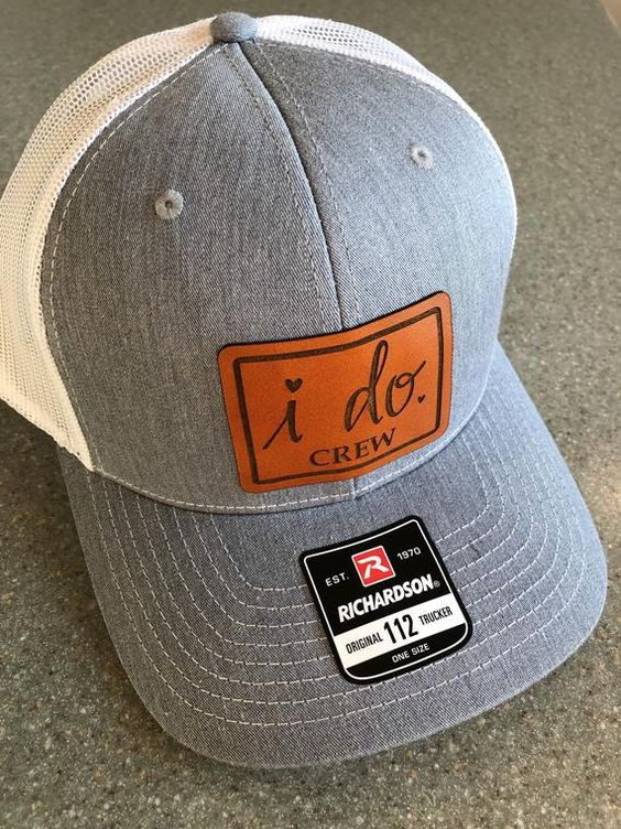 a cap with a leather tag is a nice idea to mark your groomsmen team and make it stnd out from the crowd
