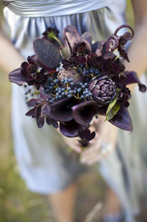 a deep purple wedding bouquet with artichokes, privet berries, dark foliage is super stylish