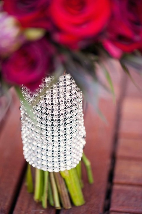 a fully embellished bouquet wrap is a very glam and chic idea for a modern bride