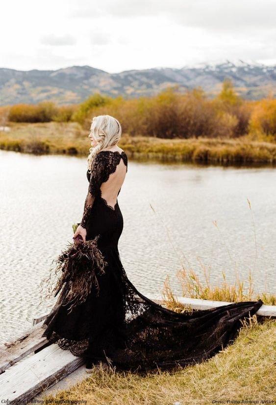 a gorgeous black lace mermaid wedding dress with an open back and a tail is very refined and chic