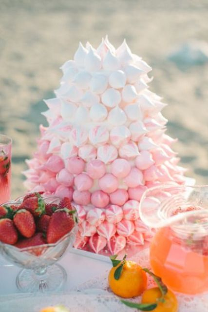 a gorgeous ombre white to pink meringue wedding cake is a unique and bold idea, an alternative to a usual one