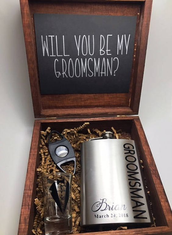 a groomsman gift box with a flask, a personalized glass, a bottle opener is a lovely and simple idea to rock