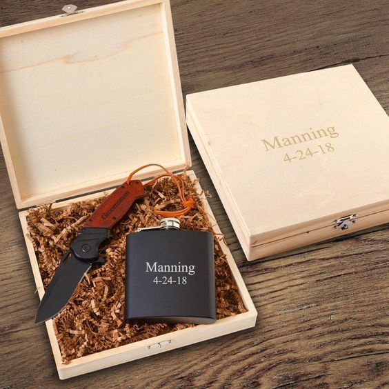 a groomsmen gift box with a flask and a knife is a very cool idea for a your friends, and it's already prepared