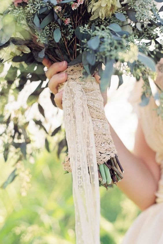 a lace bouquet wrap with long ribbons is a chic and cute idea for a rustic or vintage bride