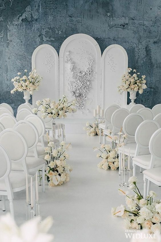 a luxurious wedding backdrop done with appliques and beads plus white or neutral bloom arrangements