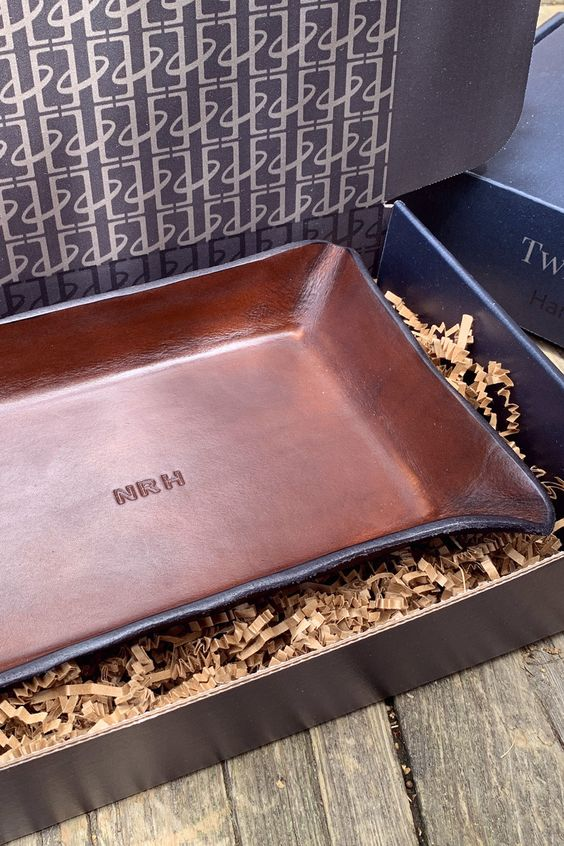 a monogrammed leather tray for small accessories and stuff is a cool groomsmen gift idea for anyone and is not hacky