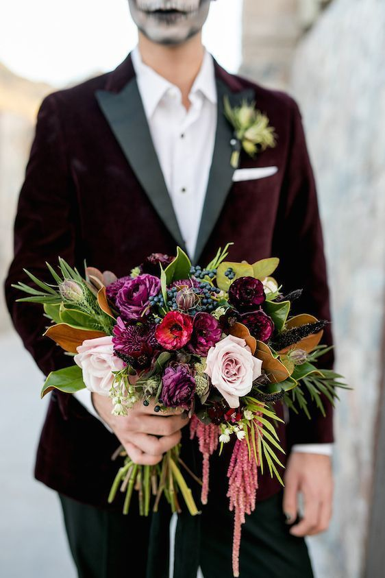 a romantic Halloween wedding bouquet with purple, red, blush blooms, foliage and privet berries is all bright and cool