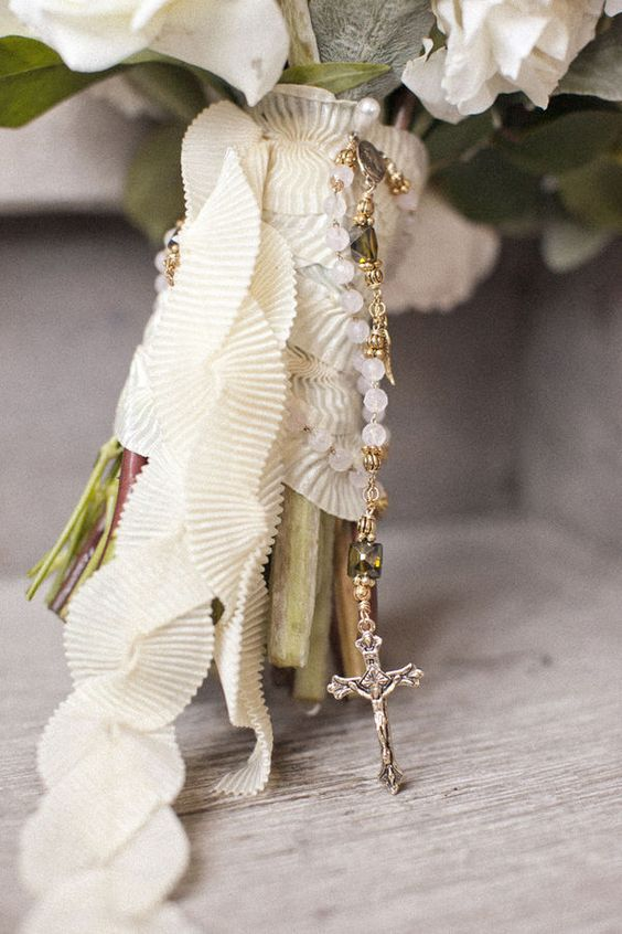a ruffle ribbon bouquet wrap with a rosary is a very refined idea for a vintage inspired wedding bouquet