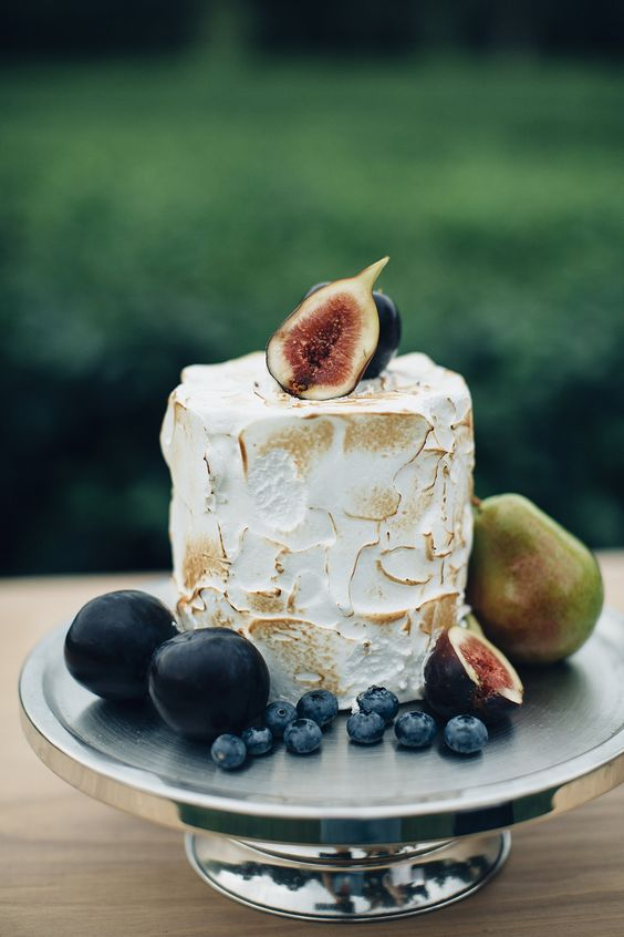 a small meringue wedding cake topped with fresh figs, with berries and pears is amazing for a fall wedding