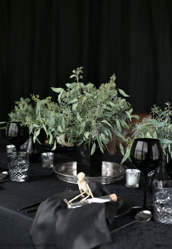 a stylish and catchy modern wedding centerpiece of a black square vase and fresh eucalyptus is a fresh idea for a Halloween wedding