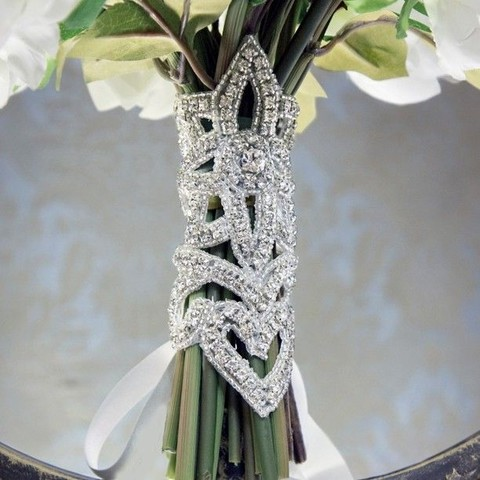 a super glam fully embeslliehd bouquet wrap with white ribbons is amaazing for an art deco or glam bouquet