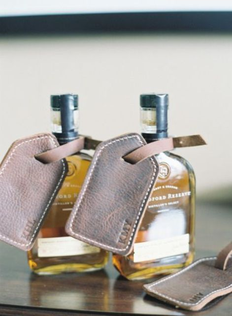 alcohol bottles with personalized leather tags are amazing as groomsmen gifts, and these tags can be used for luggager after