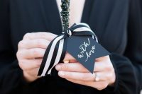 black rock candy favors with ribbon and tags are a stylish and cool idea for Halloween