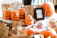 carved pumpkins and candies in paper bags are lovely Halloween wedding favors you can easily make