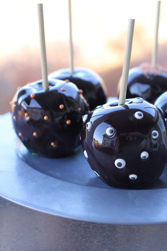 chocolate covered apples with polka dots and googly eyes are delicious wedding favors for Halloween