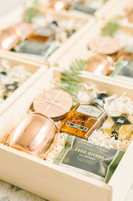 elegant groomsmen gift boxes with copper mugs, coasters, snacks, a bottle of alcohol and fern looks super cool and chic
