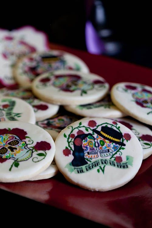 hand painted sugar skull wedding cookies is atasty favor idea and a delicious dessert