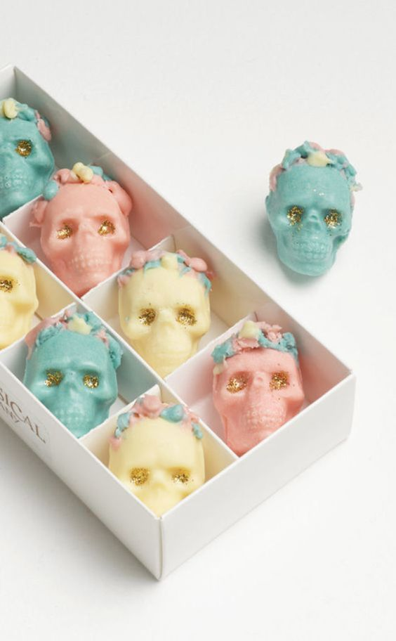 lovely pastel and gold glitter chocolate skulls will be delightful and cool Halloween wedding favors