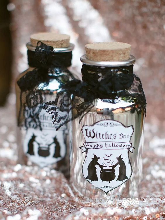 mini alcohol bottles styled as witches' brew with black lace are very cool and stylish