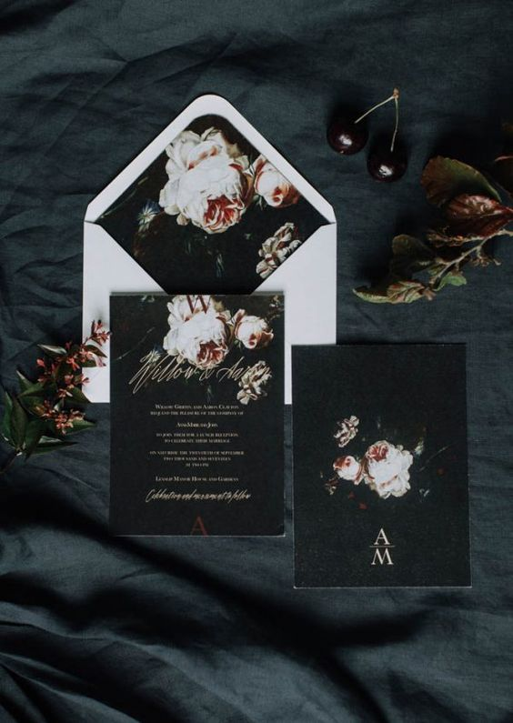 moody wedding invites in black with beautiful blooms in pink is a chic idea