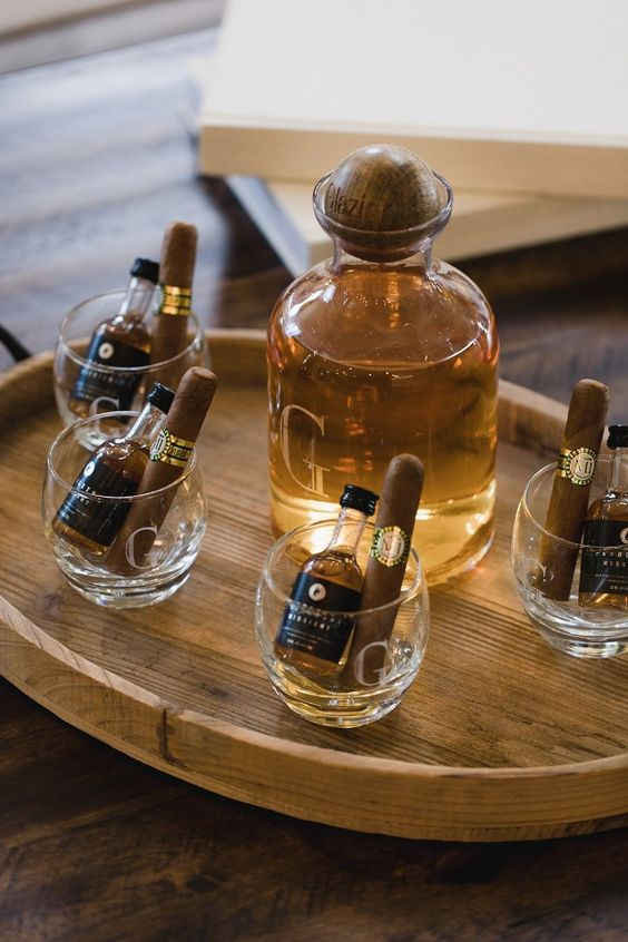personalized glasses with mini alcohol bottles and cigars are very cool to give to your groomsmen