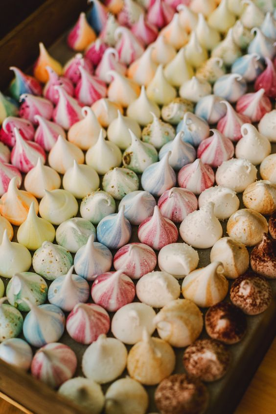 rainbow colored mini meringue kisses are amazing to serve at your wedding, especiall if it's a colorful one