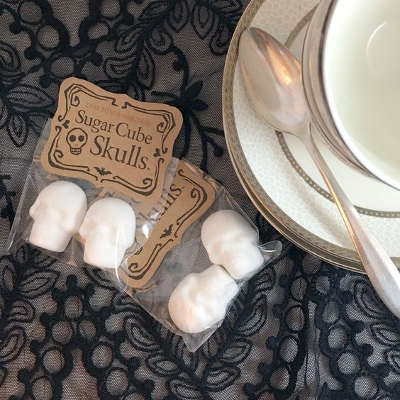 sugar cube skulls packed individually are cool and very budget-friendly Halloween wedding favors to rock