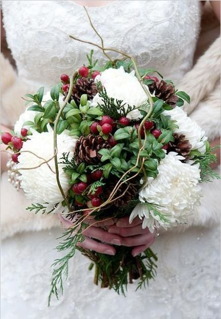 a ball-shaped Christmas wedding bouquet of greenery, white blooms, berries, twigs is a very creative option