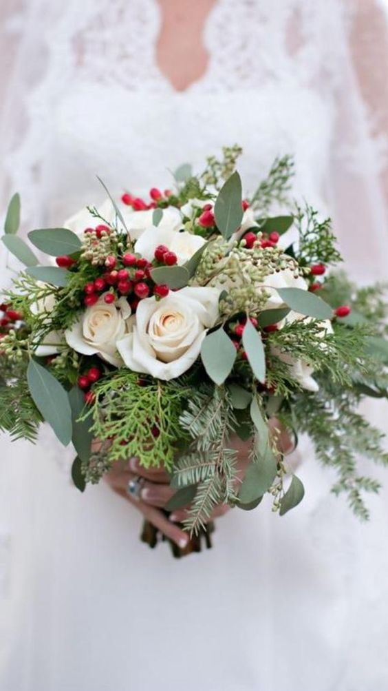 a beautiful Christmas wedding bouquet of greenery, fern, fir, white roses and berries is a timeless idea