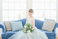 a beautiful ice blue strapless wedding dress with an embellished bodice and a layered tulle skirt is just wow