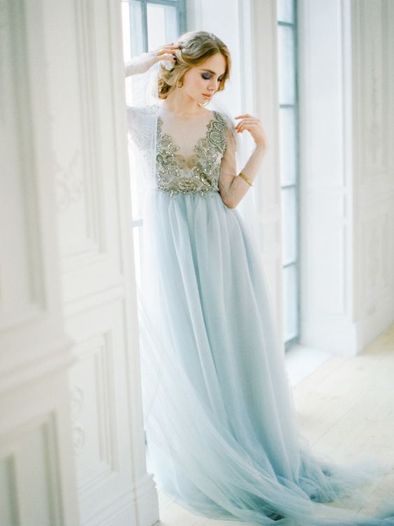 a beautiful wedding dress with an embroidered gold top and an icy blue skirt looks chic and refined