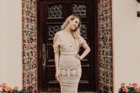 a boho bridal look with a cold shoulder crochet wedding dress with a V-neckline is a lovely idea to rock