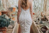 a boho crochet wedding dress with a mermaid silhouette, spaghetti straps, an open back is ideal for a boho desert wedding and will keep you cool