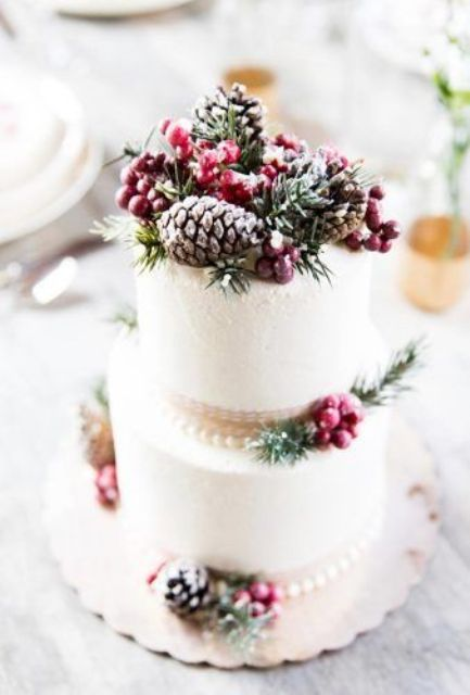 a chic Christmas wedding cake with ribbons, berries, fir twigs, pinecones is always a good idea for a holiday wedding