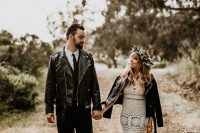 a fitting crocheted wedding dress with various patterns and an open back, a greenery crown and a black leather jacket fo a bold bridal look