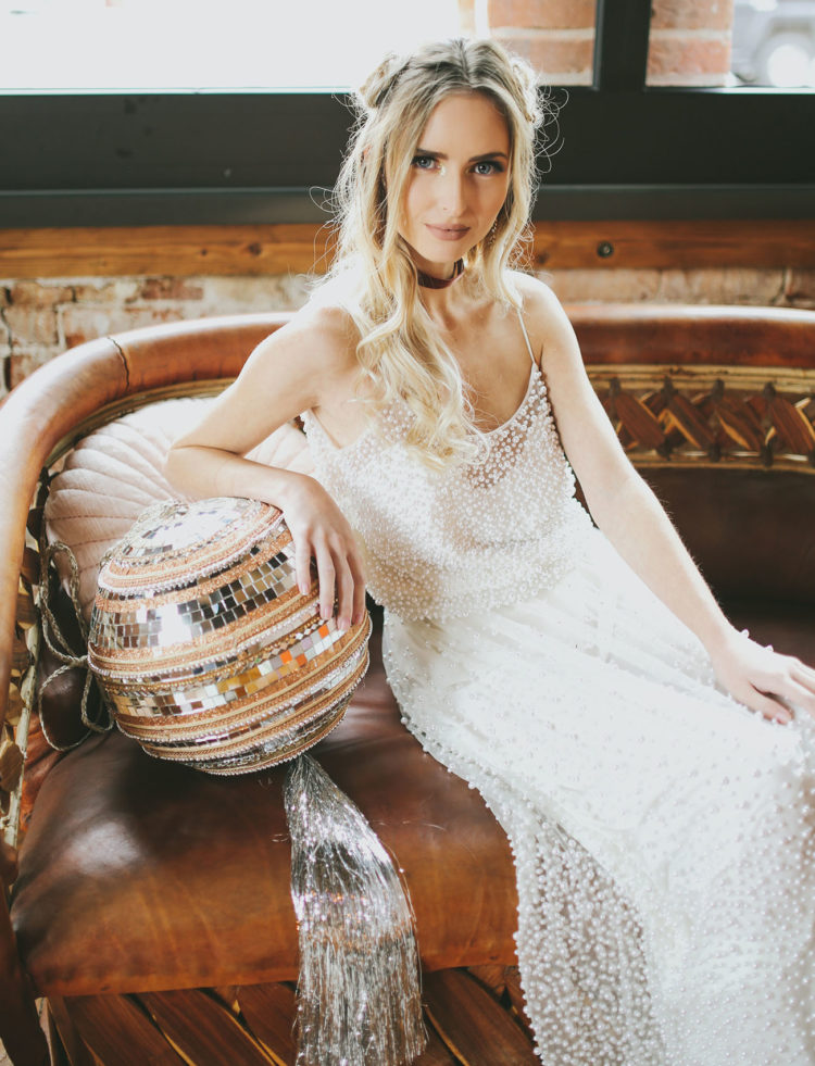 a glam fully pearled slip wedding dress and a burgundy velvet choker for a boho-inspired New Year's Eve bride