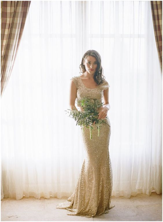 a gold sequin sheath wedding dress with a scoop neckline, cap sleeves and a train is a chic modern idea to rock