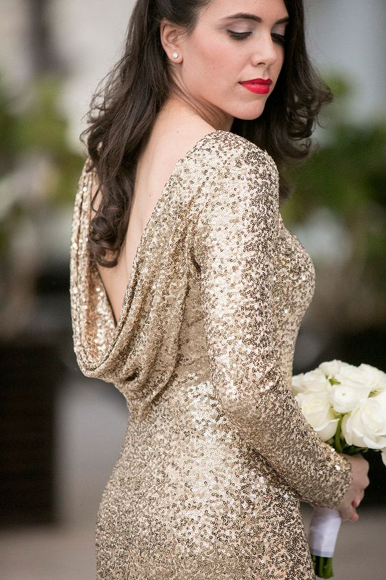 a gold sequin sheath wedding dress with long sleeves and a cowl back is a chic and glam idea for a NYE bride