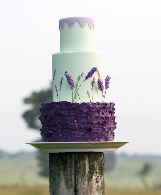 a gorgeous mint and purple wedding cake with mint sleek tiers and a purple ruffle one plus lavender and lavender lace on top